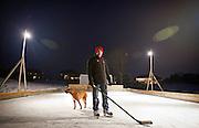 MADISON, WI — FEBRUARY 16, 2015: UW-Madison Women's Hockey Coach Mark Johnson on his personal ice rink outside his Verona home, Monday, February 16, 2015.
