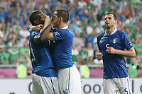 Football - European Championships 2012 - Republic of Ireland vs. Italy<br /> Leonardo Bonucci of Italy covers Mario Balotelli's mouth following his goal at the Municipal Stadium, Poznan