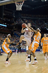 Virginia Cavaliers forward Laurynas Mikalauskas (11) is fouled by Tennessee Volunteers guard Josh Tabb (25) on his way to the basket.  The #4 seed Virginia Cavaliers were defeated by the #5 seed Tennessee Volunteers 77-74 in the second round of the Men's NCAA Tournament in Columbus, OH on March 18, 2007.