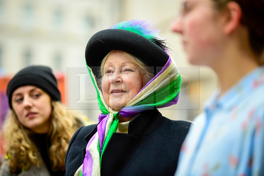 "© Licensed to London News Pictures. 19/01/2019. LONDON, UK. A woman dressed as a suffragette joins thousands of participants taking part in the Women's March in the capital, one of 30 such worldwide marches protesting against violence against women and the negative impact of austerity policies.  London's theme this year is ""Bread and Roses"", honouring Polish-American suffragette Rose Schneiderman who, in 1911 said ""The worker must have bread but she must have roses too"", in response to a factory fire where 146 mainly female garment workers died.  Photo credit: Stephen Chung/LNP"