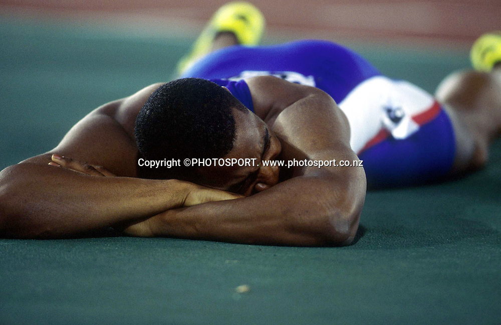 Darren Campbell of Great Britain after the Mens 200m Final at the Sydney Olympic Games, on September 28 2000. Photo: PHOTOSPORT<br /><br /><br />track and field athletics sprint sprinting exhaustion exhausted emotion disappointment