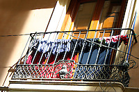 Laundry hangs from a balcony, Algarve Portugal