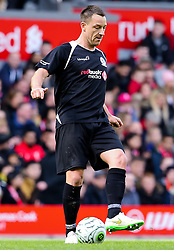 John Terry in action for the Gerrard XI - Photo mandatory by-line: Matt McNulty/JMP - Mobile: 07966 386802 - 29/03/2015 - SPORT - Football - Liverpool - Anfield Stadium - Gerrard's Squad v Carragher's Squad - Liverpool FC All stars Game