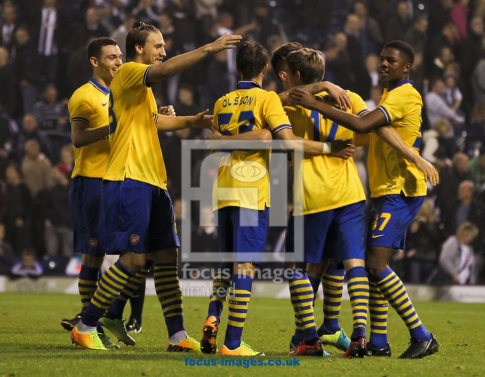 Picture by Tom Smith/Focus Images Ltd 07545141164<br /> 25/09/2013<br /> Nacho Monreal (centre right) of Arsenal celebrates with his team mates after scoring the winning penalty during the Capital One Cup match at The Hawthorns, West Bromwich.