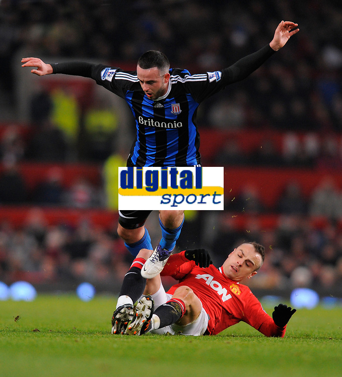 20120131: MANCHESTER, UK - Barclays Premier League 2011/2012: Manchester United vs Stoke City.<br /> In photo: Dimitar Berbatov of Manchester United challenges Marc Wilson of Stoke City.<br /> PHOTO: CITYFILES