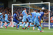 AFC Wimbledon defender Will Nightingale (5) with a header on goal during the EFL Sky Bet League 1 match between AFC Wimbledon and Coventry City at the Cherry Red Records Stadium, Kingston, England on 11 August 2018.