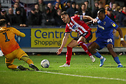 AFC Wimbledon defender Paul Kalambayi (30) battles for possession on Lincoln City box during the EFL Sky Bet League 1 match between AFC Wimbledon and Lincoln City at the Cherry Red Records Stadium, Kingston, England on 2 November 2019.