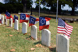 Head stones mark the graves of one unknown Union soldier and several Confederate soldiers, Confederate Cemetery, Appomattox Court House National Historical Park, Appomattox, Virginia.