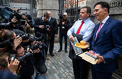 © Licensed to London News Pictures. 12/06/2018. London, UK. Aaron Banks (2-R) and Andy Wigmore (R) arrive at Portcullis House to appear before the Digital, Culture, Media and Sport Select Committee hearing as part of its enquiry into fake news. Photo credit: Rob Pinney/LNP