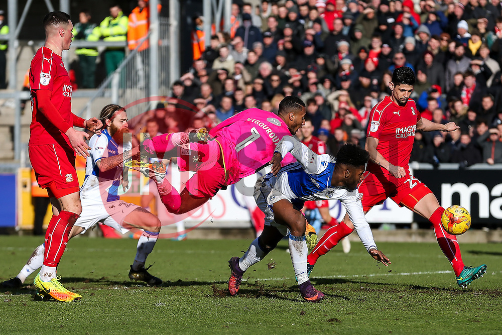Ellis Harrison of Bristol Rovers heads as he beats Lawrence Vigouroux of Swindon Town - Rogan Thomson/JMP - 28/01/2017 - FOOTBALL - Memorial Stadium - Bristol, England - Bristol Rovers v Swindon Town - Sky Bet League One.