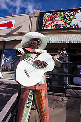 Sculpture of a guitar playing man, Madrid, New Mexico, United States of America