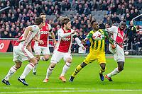 AMSTERDAM - Ajax - ADO , Voetbal , Eredivisie , Seizoen 2016/2017 , Amsterdam ArenA , 29-01-2017 ,  ADO speler Ruben Schaken (2e r) in duel met Ajax speler Davinson Sanchez (r) en Ajax speler Lasse Schone (m)