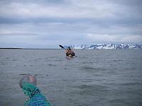 A kayaker padlling ahead