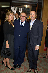 Left to right, DIANA KRALL, SIR ELTON JOHN and DAVID FURNISH at '4 Inches' a project 'For Women about Women By Women' - A photographic Auction in aid of the Elton John Aids Foundation hosted by Tamara Mellon President of Jimmy Choo and Arnaud Bamberger MD of Cartier UK at Christie's, 8 King Street, London W1 on 25th May 2005.<br />