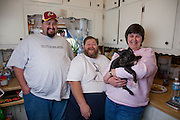 Rick Bumgardner with his wife and son at their home in Knoxville, Tennessee. Rick, disabled due to his 500 pound weight and diabetes, is dieting to reduce his weight by 100 pounds so that he can get gastric bypass surgery to lose another 200 pounds.  (Rick Bumgardener was featured in the book What I Eat: Around the World in 80 Diets.)