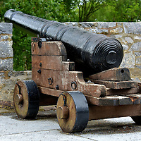 Cannon at Ross Castle in Killarney, Ireland <br /> This cannon at Ross Castle is a silent reminder of when more than 4,000 of Oliver Cromwell&rsquo;s troops led by General Ludlow stormed the stronghold in 1652 towards the end of the Eleven Year&rsquo;s War (1641 &ndash; 1653). Lord Muskerry&rsquo;s men successful repelled the foot soldiers but succumbed when English vessels arrived on Lough Leane laden with artillery.  Folklore had suggested the castle was invincible until a warship arrived on the shallow lake. The prophecy came true.