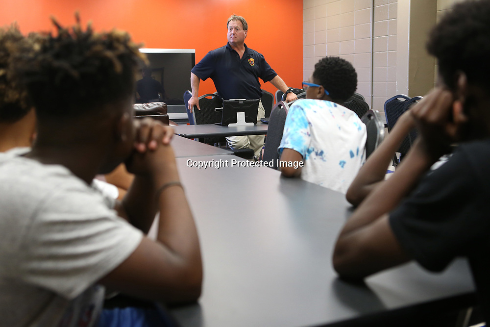 Tupelo Assistant Fire Chief Jimmy Avery speaks with young men in the PAL program about interview skills Wednesday afternoon at the PAL building.