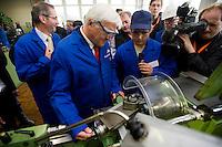29 AUG 2008, EISENHUETTENSTADT/GERMANY:<br /> Frank-Walter Steinmeier (L), SPD, Bundesaussenminister, fertigt an einer Drehmaschine ein Lot, unterstuetzt Michael Koenig (R), Auszubildender, waehrend dem Besuch des Stahlwerks ArcelorMittal Eisenhuettenstadt, der ehem. Eko Stahl, im Rahmen von Steinmeiers Sommerreise durch Brandenburg<br /> IMAGE: 20080829-01-020<br /> KEYWORDS: Eisenhüttenstadt, Blaumann