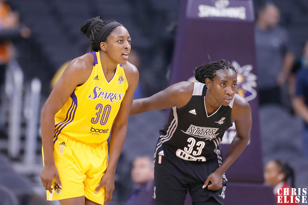 25 May 2014: Los Angeles Sparks forward Nneka Ogwumike (30) is seen next to San Antonio Stars forward Sophia Young-Malcolm (33) during the Los Angeles Sparks 83-62 victory over the San Antonio Stars, at the Staples Center, Los Angeles, California, USA.
