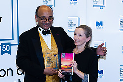 Man Booker Prize winner Anna Burns poses with her novel Milkman  and Man Booker Prize Chairman Kwame Anthony at a press conference following the award at the Guildhall in London. Guildhall, London, October 16 2018.