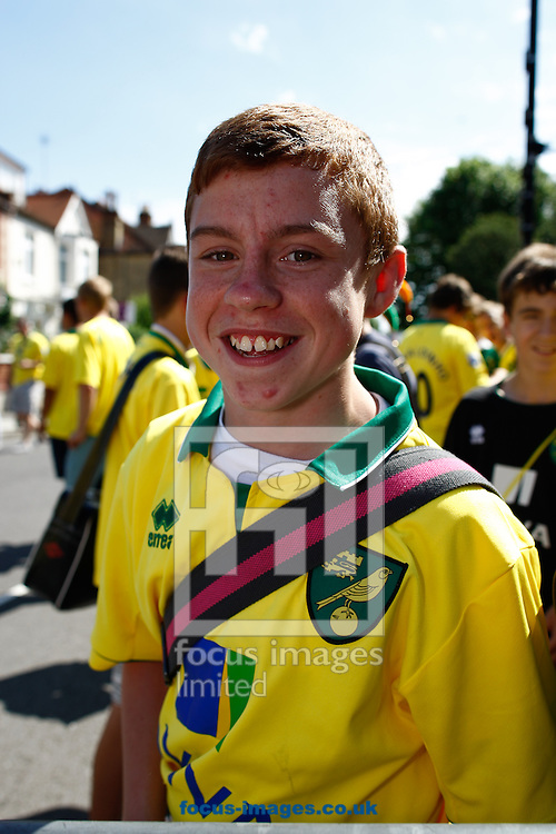 Picture by Andrew Tobin/Focus Images Ltd +44 7710 761829.18/08/2012. Norwich supporters outside the ground before the Barclays Premier League match at Craven Cottage, London.