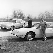 Sherwood Egbert (L) and Raymond Loewy (R) pose with the Studebaker Avanti.