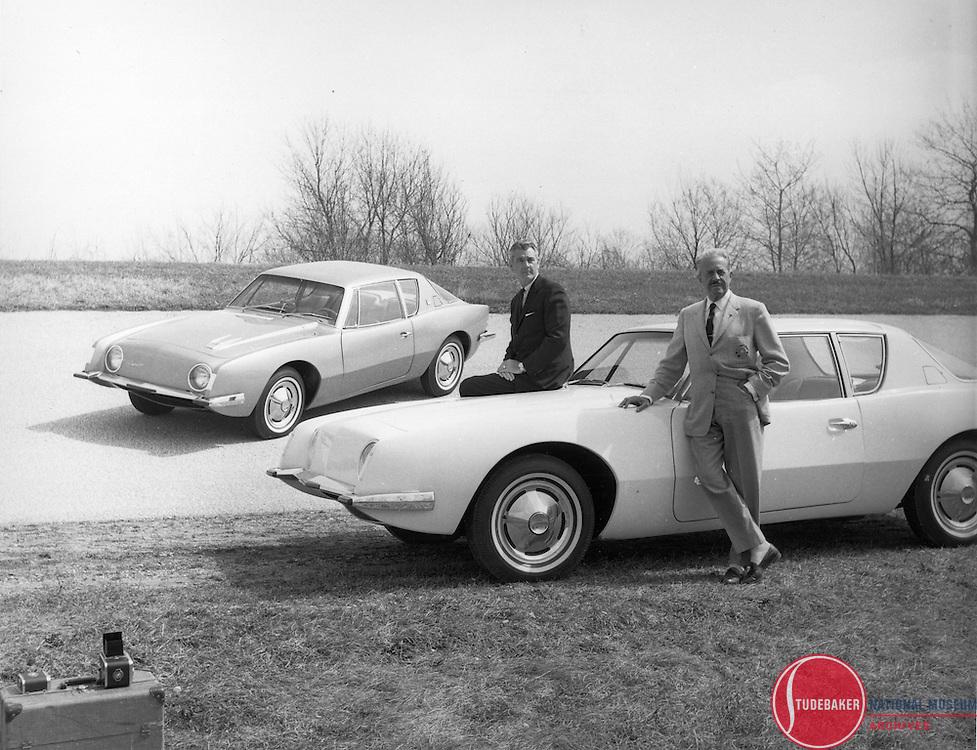 Sherwood Egbert (L) and Raymond Loewy (R) pose with the Studebaker Avanti.