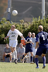 01 October 2006: Titan John Blodgett uses his head. The game remained scoreless until the 2nd overtime in which University of Dallas Crusaders Adam Lunger scored the Golden Goal to beat the Illinois Wesleyan Titans.  This game was played at Neis Field on the campus of Illinois Wesleyan University in Bloomington Illinois.