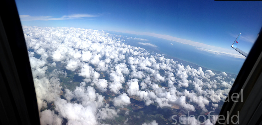 View from a Thomson Boeing 737-800 jet, en-route from Faro, Portugal to Luton. Pic using the Panoramic feature on the camera on an iPhone5.