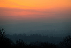 © Licensed to London News Pictures. 13/02/2017. Guildford, UK.  The sky glows red at first light viewed from Newlands Corner near Guildford.  Sunshine and warmer temperatures are expected in the south today after the recent cold spell.  Photo credit: Peter Macdiarmid/LNP