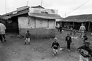 A group of children play in the area of Laini Saba in Kibera. Laini Saba translates into 'firing range' and was an area where Nubian soldiers from the King's African Rifles trained. Dozens of Nubian families once lived in the area. Now only a handful of Nubian families live there as demolitions of original Nubian homesteads have forced many to move to other more Nubian-dominated areas of Kibera like Makina, Kambi Muru and Lindi.