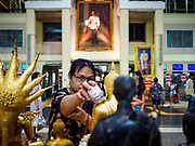 11 APRIL 2018 - BANGKOK, THAILAND:  People bathe Buddha statues in holy water to make merit at Hua Lamphong train station in Bangkok on the first day of the Songkran travel period. Songkran is the traditional Thai New Year and is one of the busiest travel periods of the year as Thais leave the capital and go back to their home provinces or resorts in tourist areas. Trains and busses are typically jammed the day before the three day Songkran holiday starts. The government has extended the official holiday period through Monday, 16 April because one day of the Songkran holiday fell on the weekend, giving many workers a five day holiday.     PHOTO BY JACK KURTZ