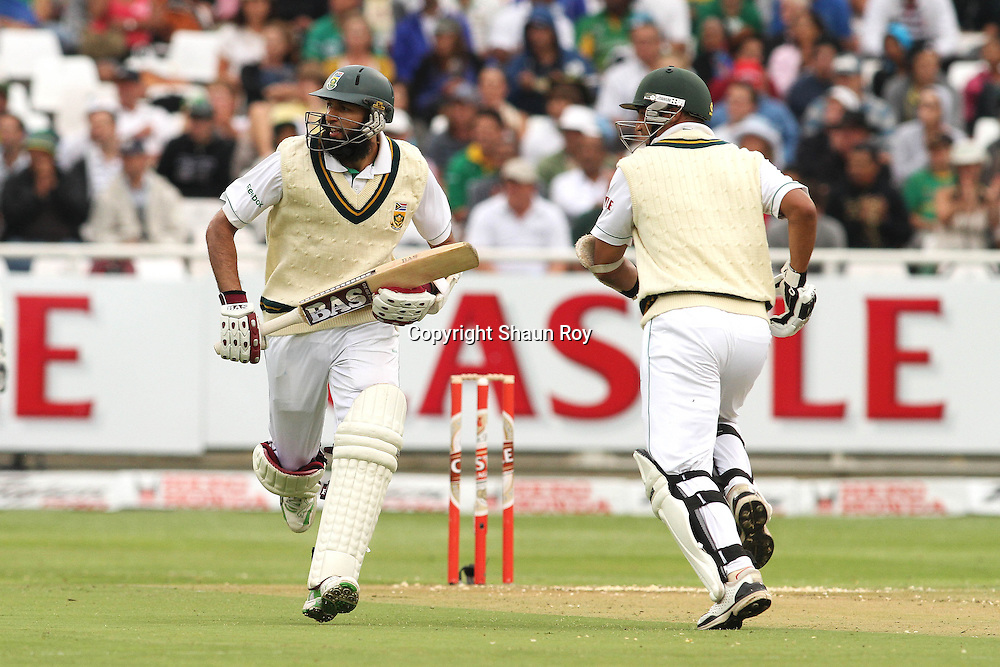 CAPE TOWN, SOUTH AFRICA - 2 January 2011, Hushim Amla of South Africa and Alviro Petersen of South Africa set off for a run during day 1 of the 3rd Castle Test between South Africa and India held at Sahara Park Newlands Stadium in Cape Town, South Africa on the 2 January 2011 .Photo by: Shaun Roy