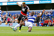 Queens Park Rangers defender Nedum Onuoha (5) gets a tackle in against Nottingham Forest forward Britt Assombalonga (9)  during the EFL Sky Bet Championship match between Queens Park Rangers and Nottingham Forest at the Loftus Road Stadium, London, England on 29 April 2017. Photo by Andy Walter.