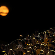 The moon rises over Topsail High School Football stadium.