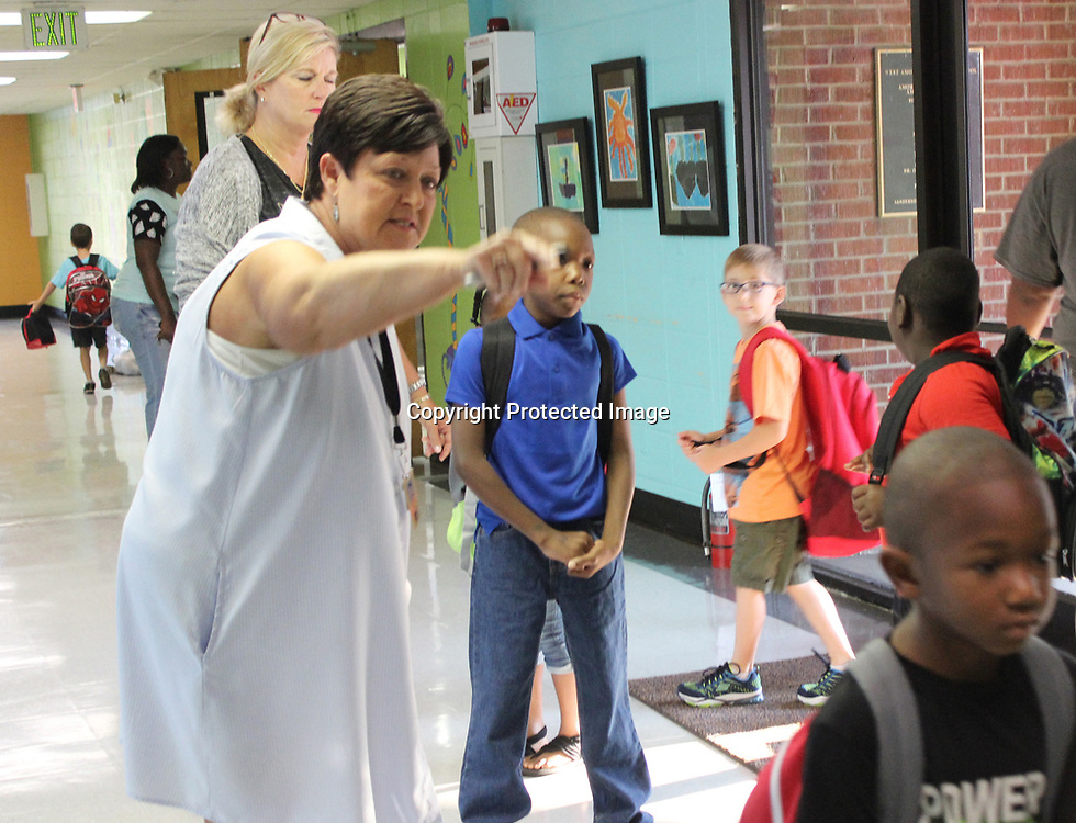 RAY VAN DUSEN/BUY AT PHOTOS.MONROECOUNTYJOURNAL.COM<br /> Donna East directs students of which way to go for their classrooms during the first day of school at West Amory Elementary School Aug. 4.