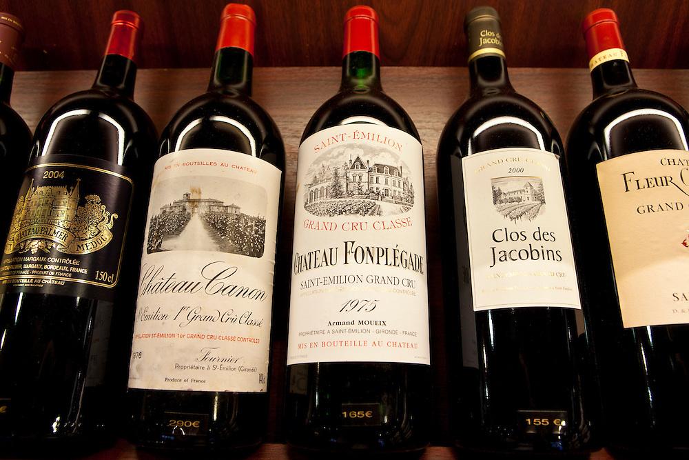 Fine wines Chateau Canon, Chateau Fonplegade, Clos des Jacobins Chateau Palmer Medoc in wine merchants shop in St Emilion, Bordeaux, France