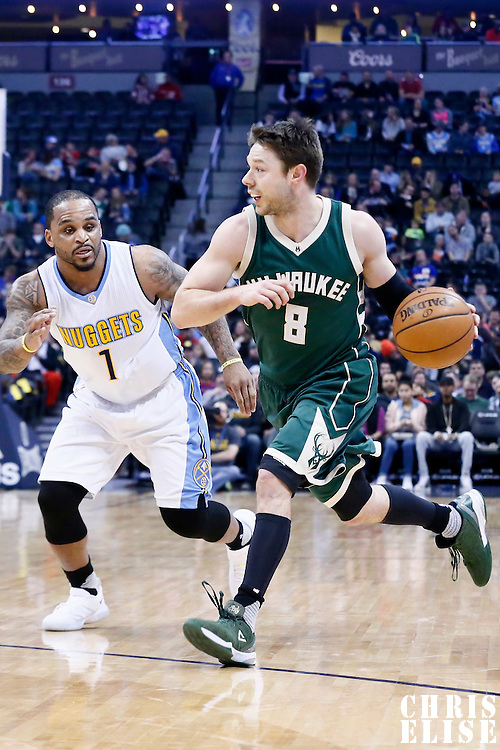 03 February 2016: Milwaukee Bucks guard Matthew Dellavedova (8) drives past Denver Nuggets guard Jameer Nelson (1) during the Denver Nuggets 121-117 victory over the Milwaukee Bucks, at the Pepsi Center, Denver, Colorado, USA.