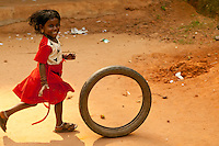 little girl playing in Kerala, India