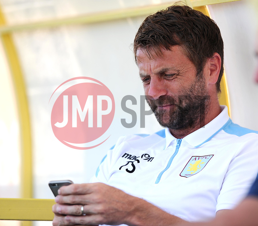 Aston Villa Manager, Tim Sherwood reads a message on his phone  - Photo mandatory by-line: Joe Meredith/JMP - Mobile: 07966 386802 - 17/07/2015 - SPORT - Football - Albufeira - Estadio Da Nora - Pre-Season Friendly