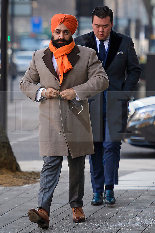 © Licensed to London News Pictures. 18/01/2017. London, UK. Conservative Party donor and Businessman PETER SINGH VIRDEE, flanked by security guards as he arrives at Westminster Magistrates Court in London where he faces extradition to Germany. Mr Virdee, who was arrested at Heathrow airport, is accused by German prosecutors of being part of a criminal enterprise to defraud the authorities of €125m (£109m) of VAT on carbon credits under the EU Emissions Trading Scheme. Photo credit: Ben Cawthra/LNP