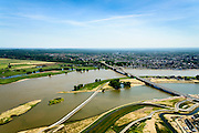 Nederland, Gelderland, Nijmegen, 09-06-2016; de nieuw aangelegde nevengeul van de rivier de Waal, ontstaan door de dijkverlegging bij Lent, gezien naar de binnenstad van Nijmegen. Onderdeel van het project Ruimte voor de River (Ruimte voor de Waal). Links van het midden de ingang van de nevengeul met drempel.<br /> The finished dike relocation of Lent (project Ruimte voor de Rivier: Room for the River) with the resulting flood trench. Left of the center the entrance to the secondary channel with the threshold. In the background the city of Nijmegen.<br /> luchtfoto (toeslag op standard tarieven);<br /> aerial photo (additional fee required);<br /> copyright foto/photo Siebe Swart