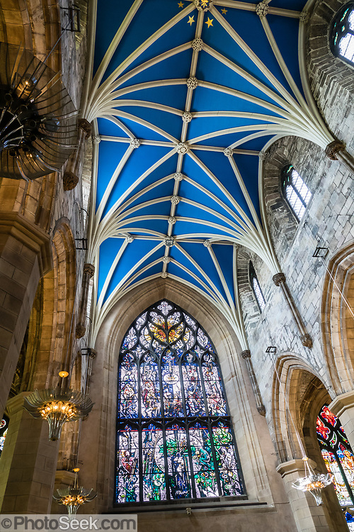 "Vaulted blue ceiling of St Giles' Cathedral (High Kirk of Edinburgh), the principal place of worship of the Church of Scotland in Edinburgh. Its distinctive crown steeple is a prominent feature of the city skyline, at about a third of the way down the Royal Mile. The church has been one of Edinburgh's religious focal points for approximately 900 years. The present church dates from the late 1300s, though it was extensively restored in the 1800s. Today it is sometimes regarded as the ""Mother Church of Presbyterianism."" The cathedral is dedicated to Saint Giles, who is the patron saint of Edinburgh, as well as of cripples and lepers, and was a very popular saint in the Middle Ages. Edinburgh is the capital city of Scotland, in Lothian on the Firth of Forth's southern shore, Scotland, United Kingdom, Europe."