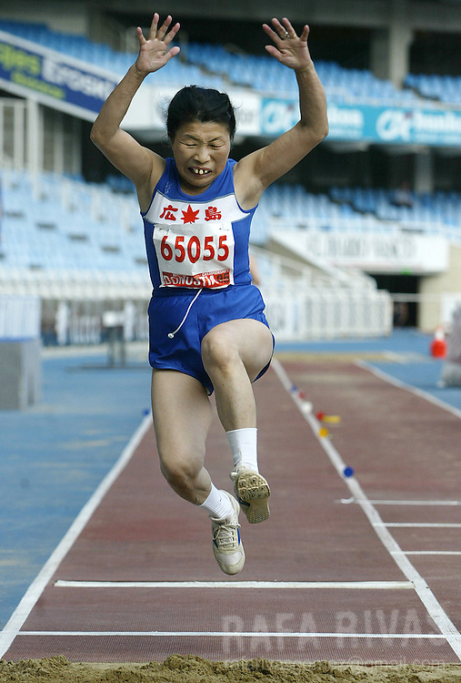 Japanese athlete Tokiko Ichigaki, 66, takes part in the women's long jump final, 29 August 2005 during the celebration of the XVI WMA World Master Athletics Championships Stadia 2005, in the northern Spanish Basque town of San Sebastian.