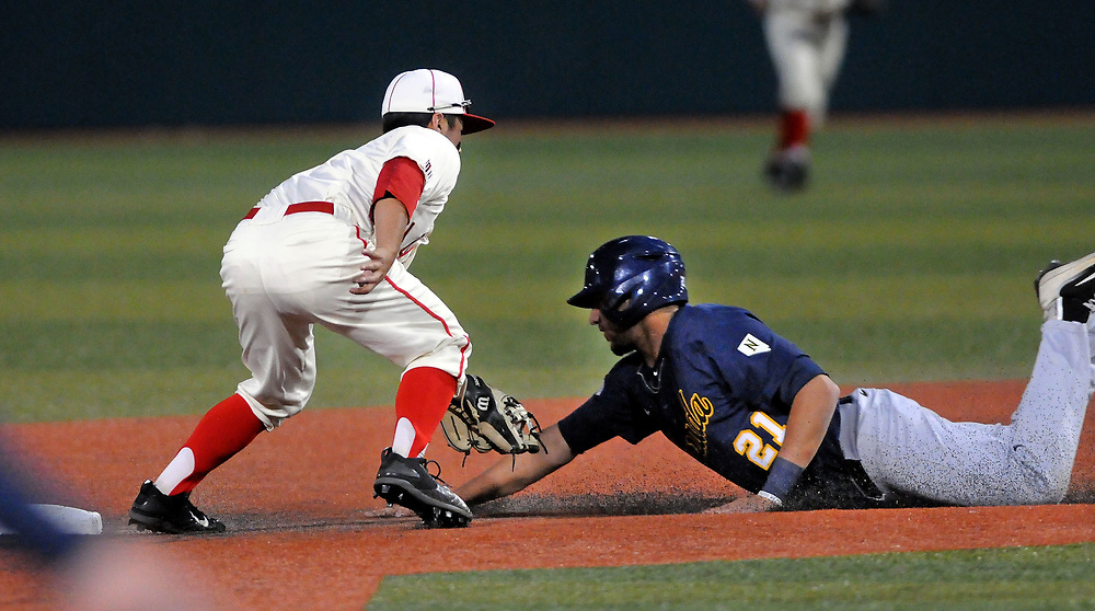 jt051817i/ sports/jim thompson/  UNM's second baseman #5 Justin Water makes the tag on Nevada's # 21 Jordan Pearce in their game Thursday night. Thursday May. 18, 2017. (Jim Thompson/Albuquerque Journal)