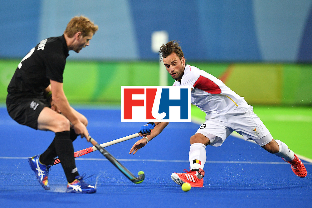 Belgium's Sebastien Dockier (R) and New Zealand's Blair Tarrant vie during the mens's field hockey Belgium vs New Zealand match of the Rio 2016 Olympics Games at the Olympic Hockey Centre in Rio de Janeiro on August, 12 2016. / AFP / Carl DE SOUZA        (Photo credit should read CARL DE SOUZA/AFP/Getty Images)