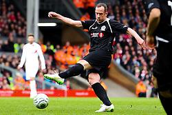 Charlie Adam fires a shot towards goal    - Photo mandatory by-line: Matt McNulty/JMP - Mobile: 07966 386802 - 29/03/2015 - SPORT - Football - Liverpool - Anfield Stadium - Gerrard's Squad v Carragher's Squad - Liverpool FC All stars Game
