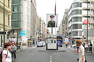 Once upon a time just a  gray border post  nowadays Checkpoint Charlie is a piece of history in the new Berlin.