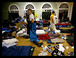 13 July 2006 - New Orleans - Louisiana. Christian Volunteers. Group Workcamps Foundation (GWF). Carrolton United Methodist Church. Groups of around 100 Christian affiliated church kids of predominantly high school age come from all across the USA to the city for a 5 day week where they put in an average of 2,080 hours of community service as they volunteer to gut, clean and rebuild houses for residents in Katrina ravaged parts of New Orleans. The kids and their carers live in an old church Uptown where they sleep in segregated dormitories and all pitch in in a communal atmosphere. Kids celebrate the end of their week together and mess around in one of their dormitories on the last night of their trip. GWF, formed in 1976, based in Loveland, Colorado organises religious missions volunteering in disaster recovery at no charge to residents. The city would not be rebuilt without their help. They are a Godsend to those they help and are greatly appreciated for all that they do for those they help.