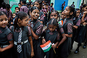 On India's Independence Day 2012, Poonam, 10, (third from left) and the pupils in her school are celebrating along the streets of Oriya Basti, one of the water-contaminated colonies in Bhopal, central India, near the abandoned Union Carbide (now DOW Chemical) industrial complex, site of the infamous '1984 Gas Disaster'.